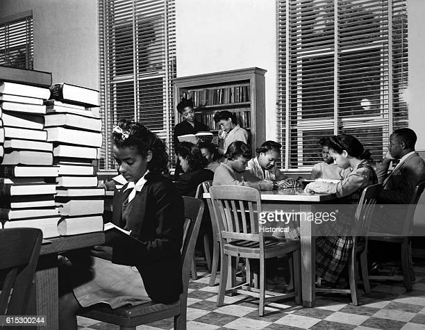 Students work in the reading room of the Harrison Rhodes Memorial Library at BethuneCookman College Daytona Beach Florida February 1943