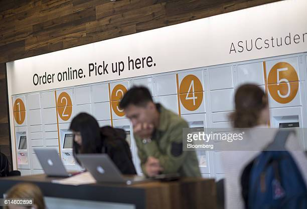 Students work on computers inside an Amazoncom Inc kiosk on the University of California Berkeley campus in Berkeley California US on Wednesday Oct...