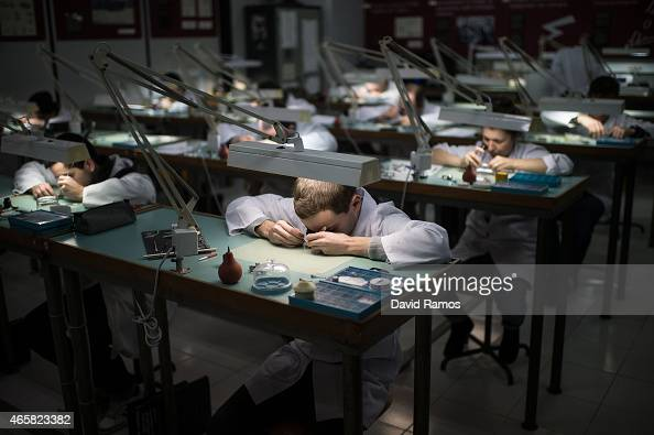 Students work on the mechanism of wristwatches as they attend a class at the secondary school Mare de Deu de la Merce on March 10 2015 in Barcelona...