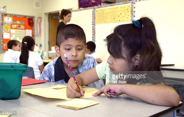 Students work together in teacher Daisy Moran's secondgrade bilingual class during summer school at Mozart School July 2 2003 in Chicago Illinois A...