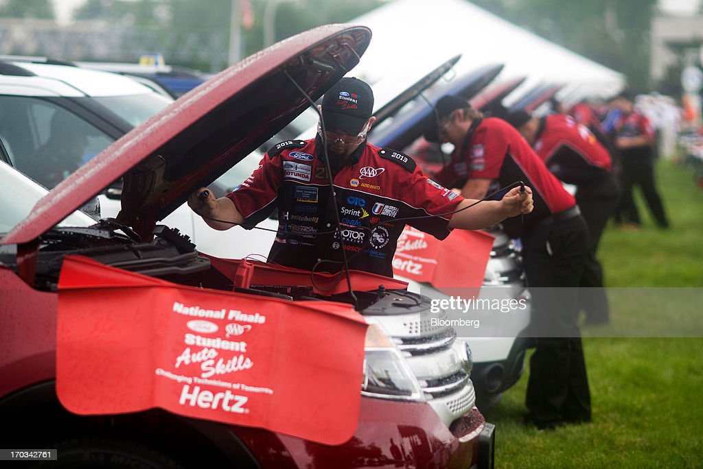 Students work under the hoods of Ford Motor Co. Explorers at the National Finals of the Annual Ford/AAA Student Auto Skills Competition at the Ford World Headquarters in Dearborn, Michigan, U.S., on Tuesday, June 11, 2013. Job openings in the U.S. fell in April, showing companies were waiting to assess the effects of higher taxes and reduced government spending before committing to bigger staff increases. Photographer: Ty Wright/Bloomberg via Getty Images