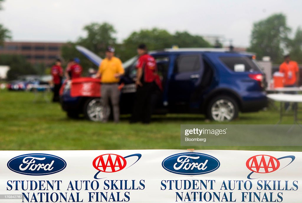 Students work under the hoods of Ford Motor Co. Explorers at the National Finals of the Annual Ford/AAA Student Auto Skills Competition at the Ford World Headquarters in in Dearborn, Michigan, U.S., on Tuesday, June 11, 2013. Job openings in the U.S. fell in April, showing companies were waiting to assess the effects of higher taxes and reduced government spending before committing to bigger staff increases. Photographer: Ty Wright/Bloomberg via Getty Images