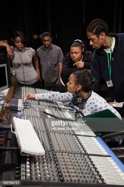 Students working with sound mixer