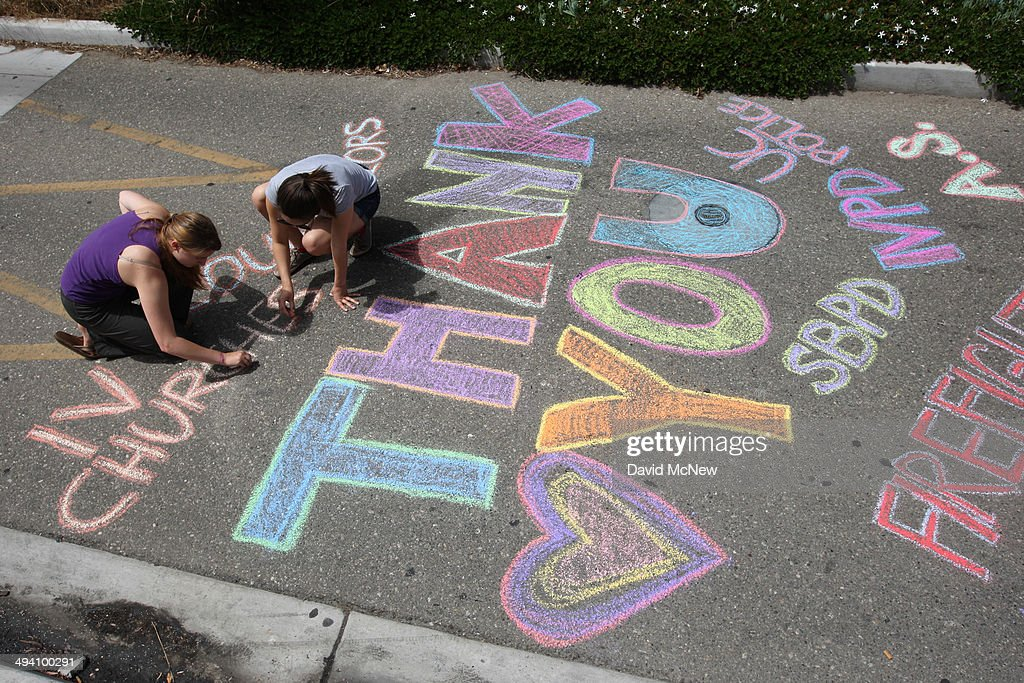 Students write chalk messages of thanks in the street on the Day of Mourning and Reflection for the victims of a killing spree at University of California, Santa Barbara on May 27, 2014 in Isla Vista, California. Elliot Rodger killed six college students at the start of Memorial Day weekend and wounded seven other people, stabbing three then shooting and running people down in his BMW near UCSB before shooting himself in the head as he drove. Police officers found three legally-purchased guns registered to him inside the vehicle. Prior to the murders, Rodger posted YouTube videos declaring his intention to annihilate the girls who rejected him sexually and others in retaliation for his remaining a virgin at age 22.