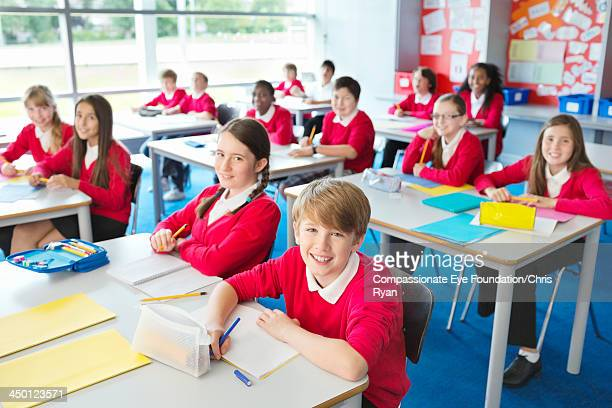 Students writing in classroom