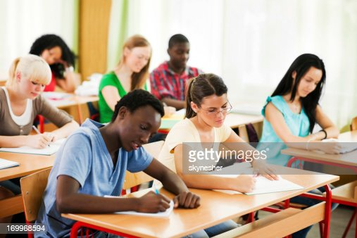Students writing in their notebooks.