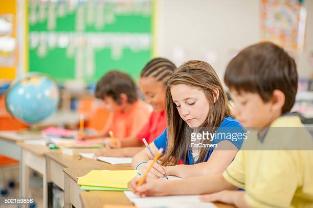 Students Writing in Their Notebooks