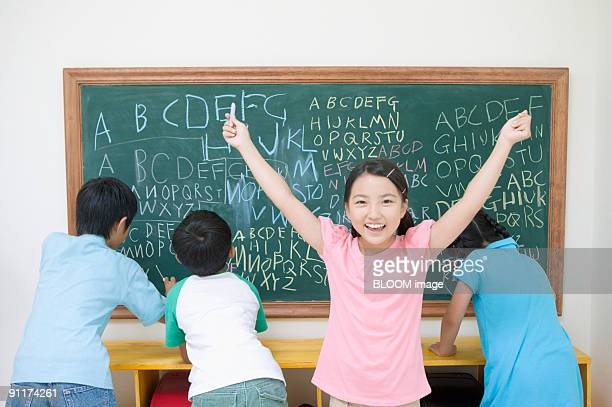 Students writing on chalkboard