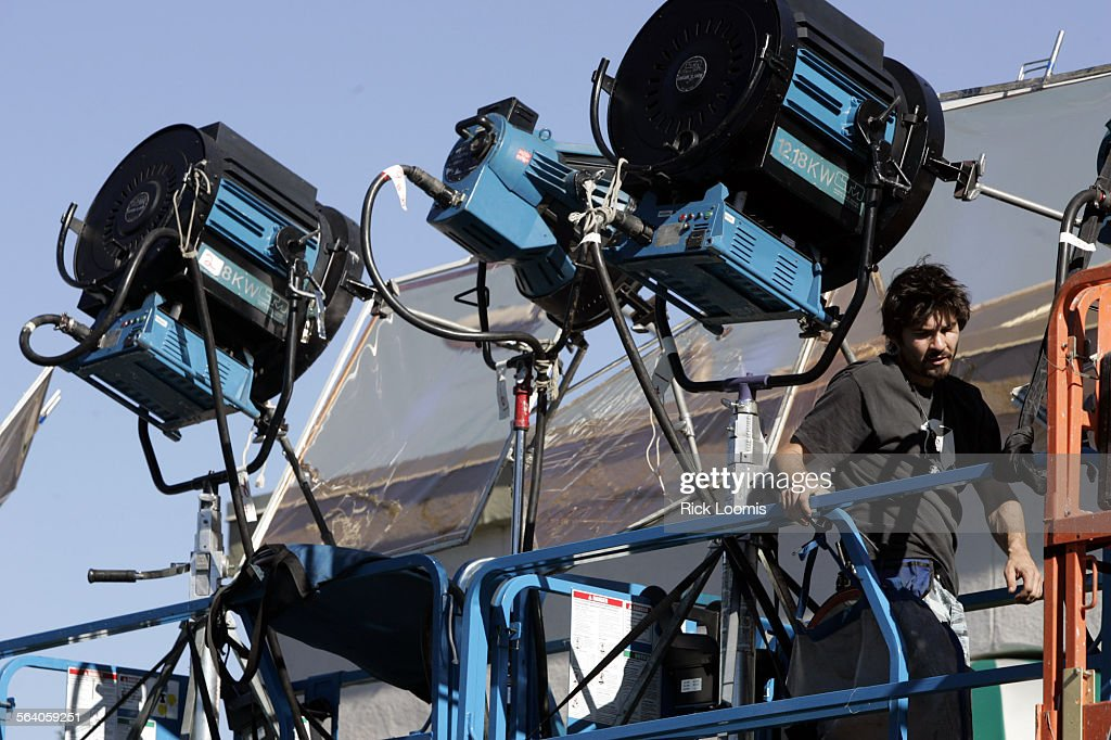 lighting technician. studio city u2013 set lighting technician beau richards works on the where filming was in i
