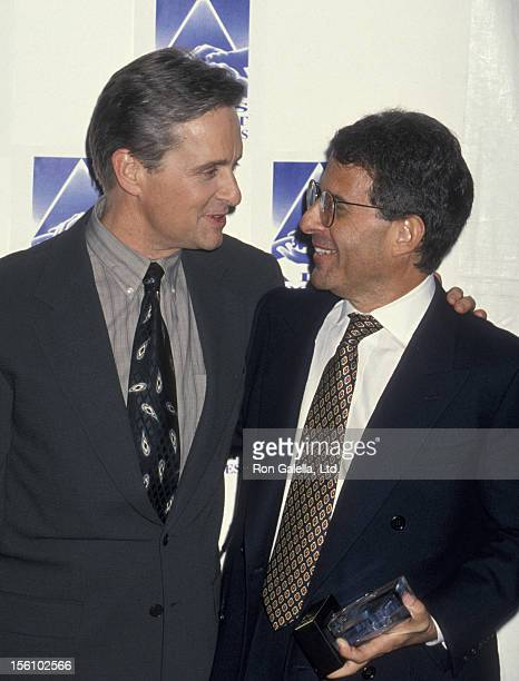 Studio executive Ron Meyer and actor Michael Douglas attending 'APLA Commitment to Life VIII' on January 19 1995 at the Universal Ampitheater in...