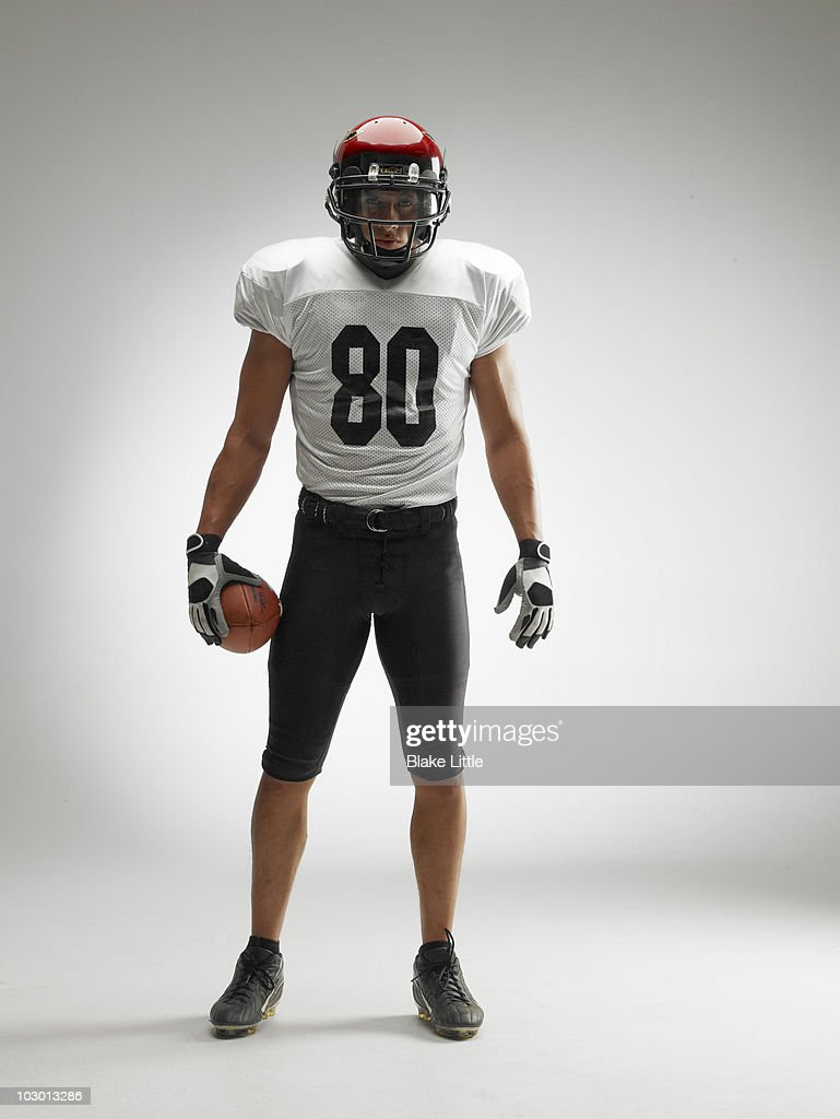 Studio football player : Stock Photo