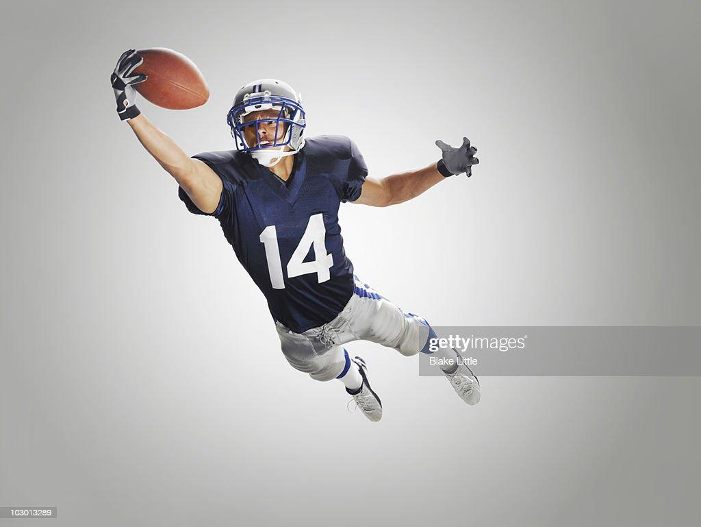 Studio football player : Stock Photo