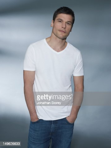 Studio front shot of male, hands in jean pockets