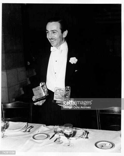 Studio head Walt Disney Walt Disney receives awards for best short cartoon at the 11th Academy Awards presented on February 23 1939 at the Biltmore...