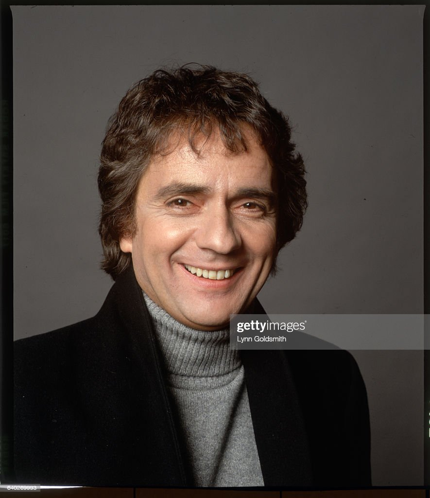 Studio headshot of actor <a gi-track='captionPersonalityLinkClicked' href=/galleries/search?phrase=Dudley+Moore&family=editorial&specificpeople=209351 ng-click='$event.stopPropagation()'>Dudley Moore</a>. He is shown smiling, wearing a turtleneck sweater. Undated photograph.