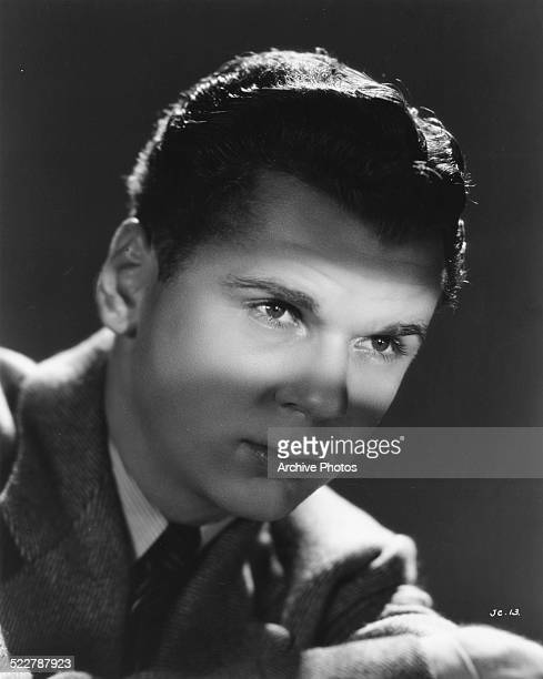 Studio headshot of actor Jackie Cooper with a spotlight highlighting his eyes for Universal Pictures 1939
