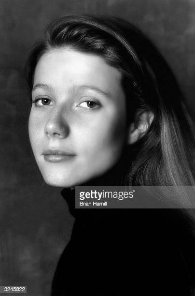 Studio headshot portrait of American actor Gwyneth Paltrow wearing a dark turtleneck sweater