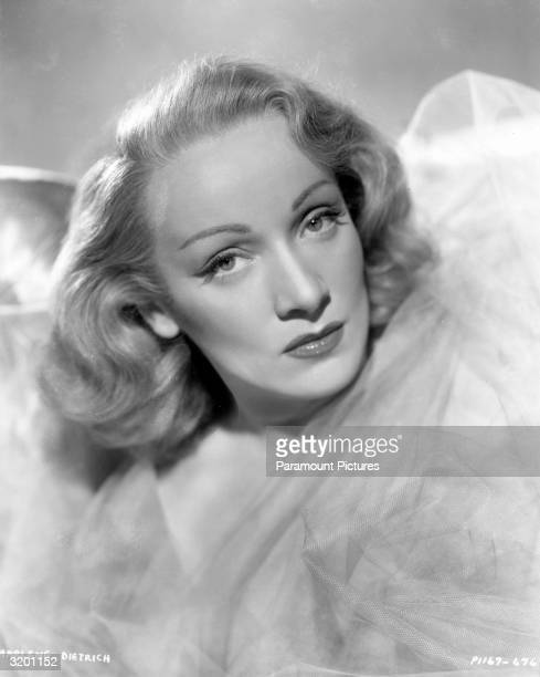 Studio headshot portrait of Germanborn actor Marlene Dietrich in costume in the film 'Angel' Dietrich's chinlength bob is blonde and wavy