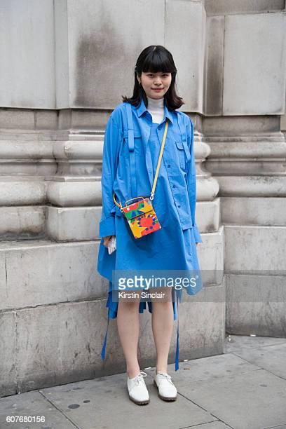 Studio Manager April Zhou is wearing jacket dress and bag by Angel Chen and shoes by Ftrompe day 1 of London Womens Fashion Week Spring/Summer 2016...