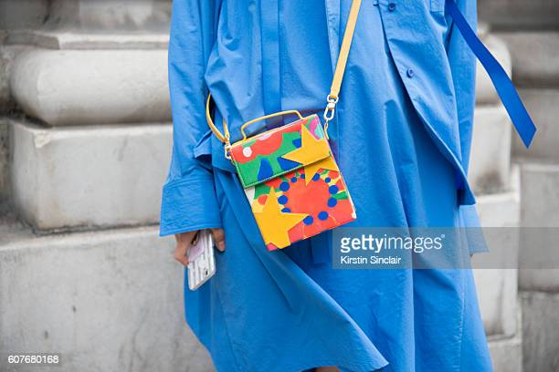 Studio Manager April Zhou is wearing jacket dress and bag by Angel Chen and day 1 of London Womens Fashion Week Spring/Summer 2016 on September 16...