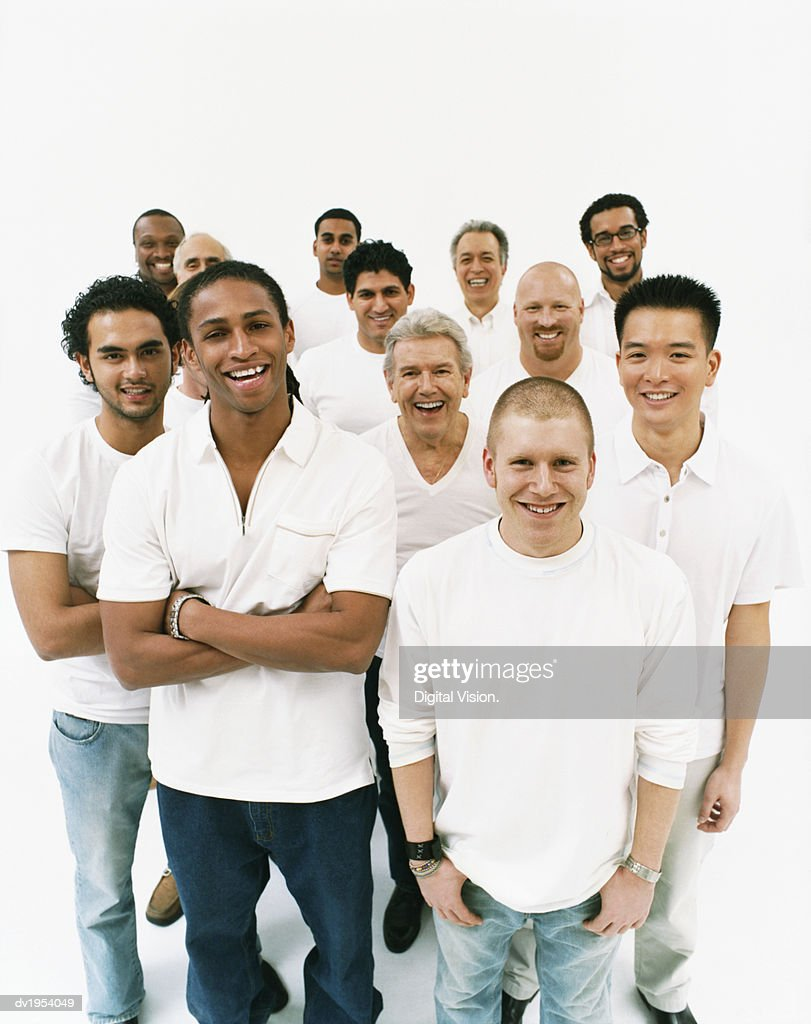 Studio Portrait of a Mixed Age, Multiethnic, Large Group of Happy Men Wearing White Tops : Stock Photo