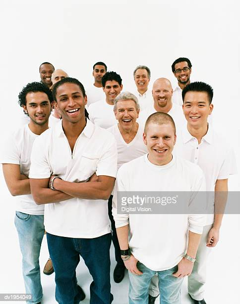 Studio Portrait of a Mixed Age, Multiethnic, Large Group of Happy Men Wearing White Tops