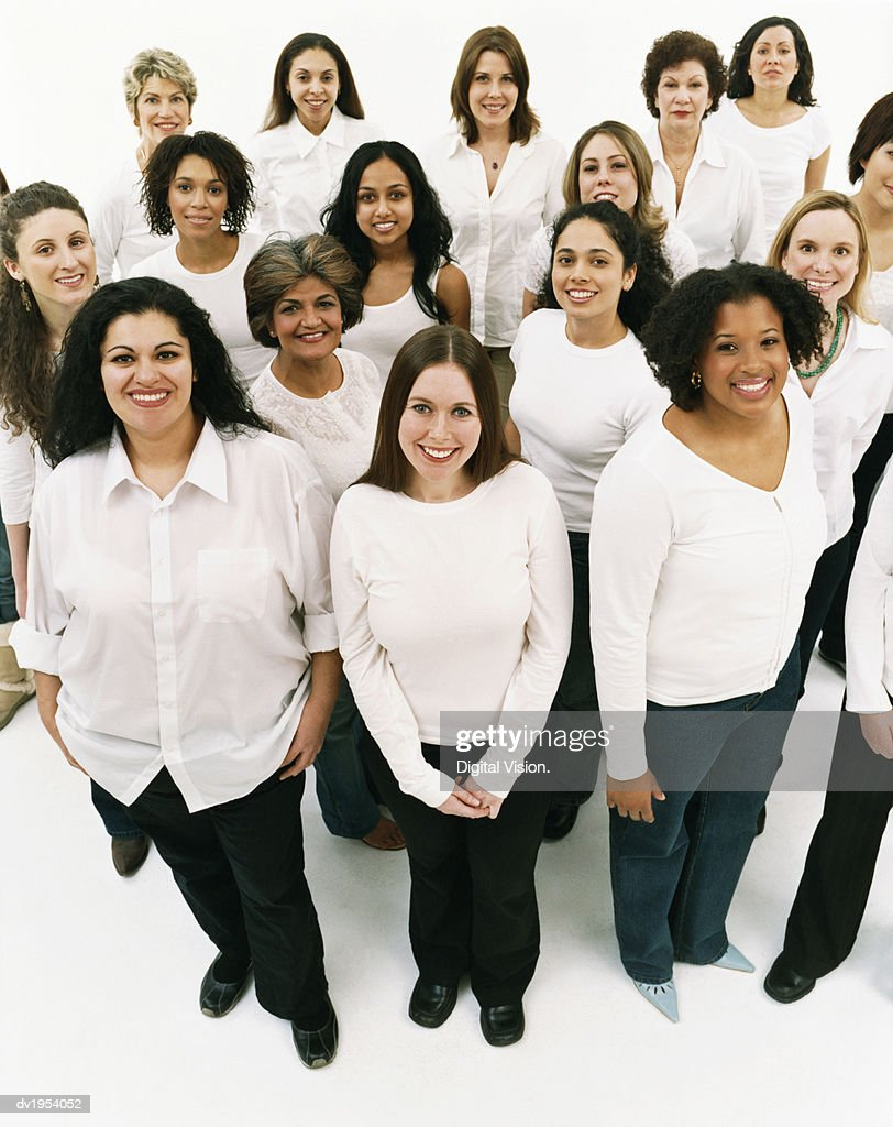 Studio Portrait of a Mixed Age, Multiethnic, Large Group of Happy Women Wearing White Tops : Stock Photo