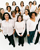 Studio Portrait of a Mixed Age, Multiethnic, Large Group of Happy Women Wearing White Tops