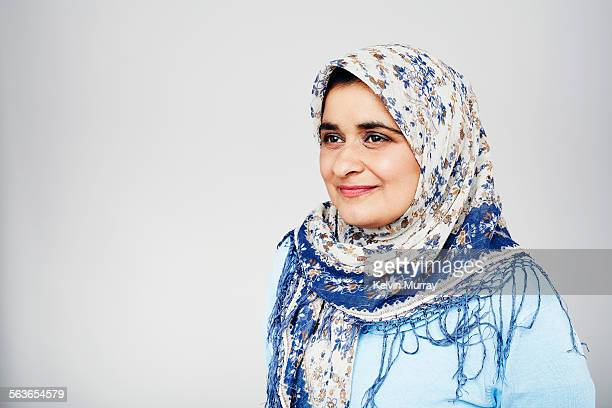 A studio portrait of a muslim lady