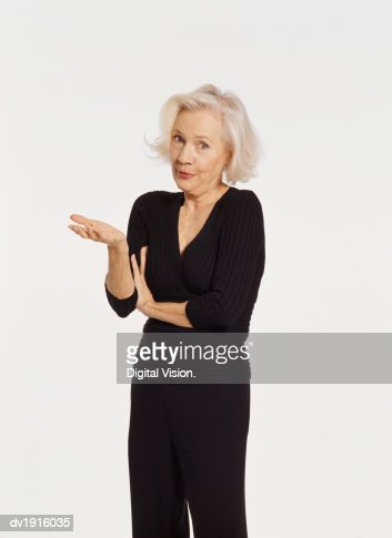 Studio Portrait of a Senior Woman Gesturing and Talking : Photo