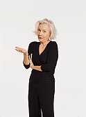 Studio Portrait of a Senior Woman Gesturing and Talking