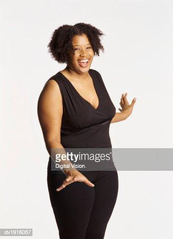 Studio Portrait of a Smiling Voluptuous Woman
