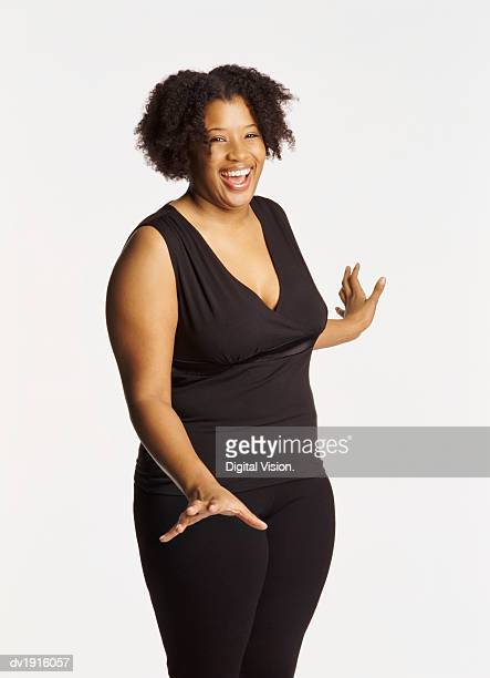 Studio Portrait of a Smiling Voluptuous Woman