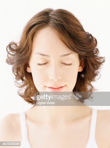 Studio Portrait of a Woman With Her Eyes Closed : Stock Photo