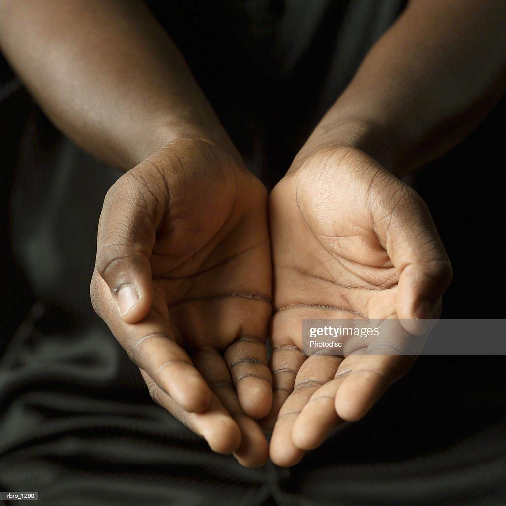 Studio portrait of a young man's hands