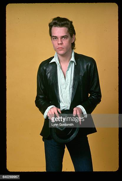 Studio portrait of actor/musician David Johansen He is shown in a 3/4length view holding a leather hat Undated photograph
