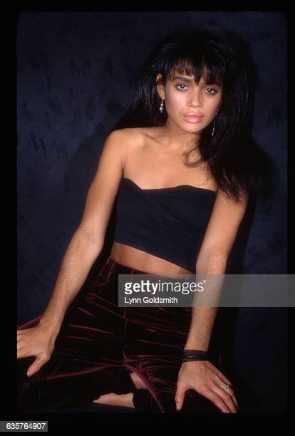 Studio portrait of actress Lisa Bonet She is shown in a 3/4length view wearing velvet pants and a bandeau top Photograph 1988