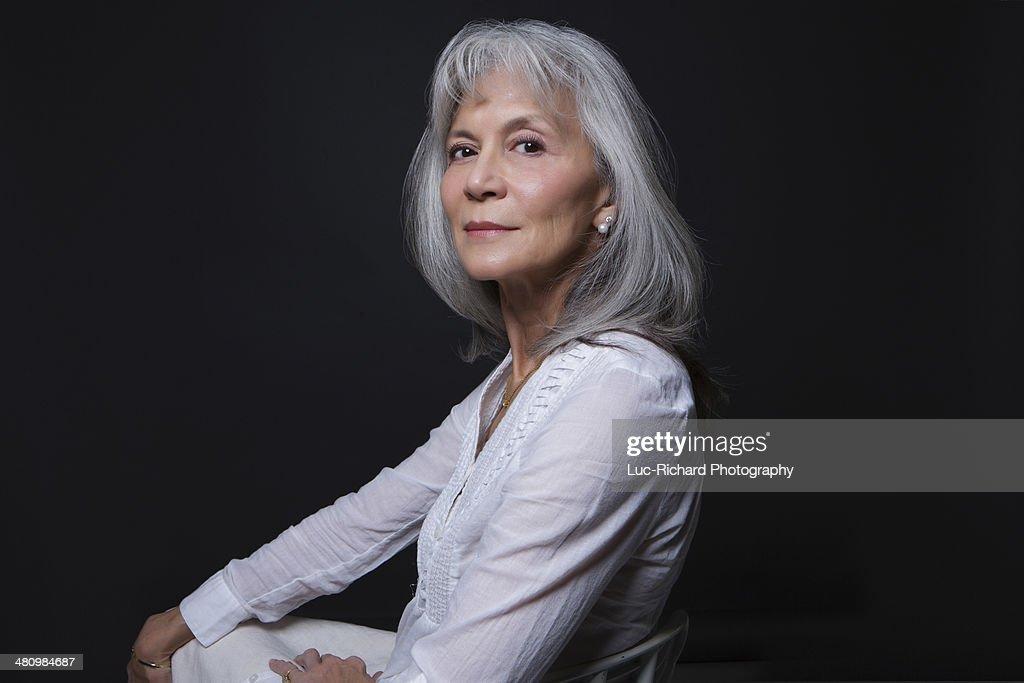 Studio portrait of aloof senior woman : Stock Photo