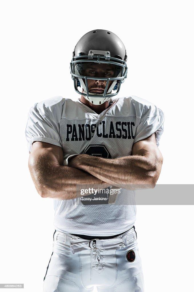 Studio portrait of american football player