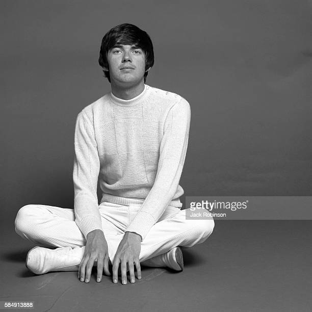 Studio portrait of American musician Jimmy Webb as he sits crosslegged on the floor New York New York April 1968