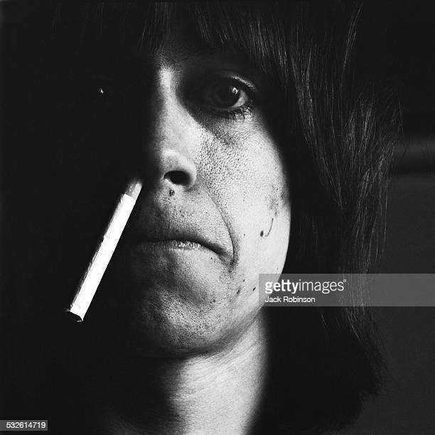 Studio portrait of American rock singer Iggy Pop of the group the Stooges with a cigarette hanging from his nose February 22 1970