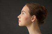 Studio portrait of an attractive 18 year old female ballet dancer on black background