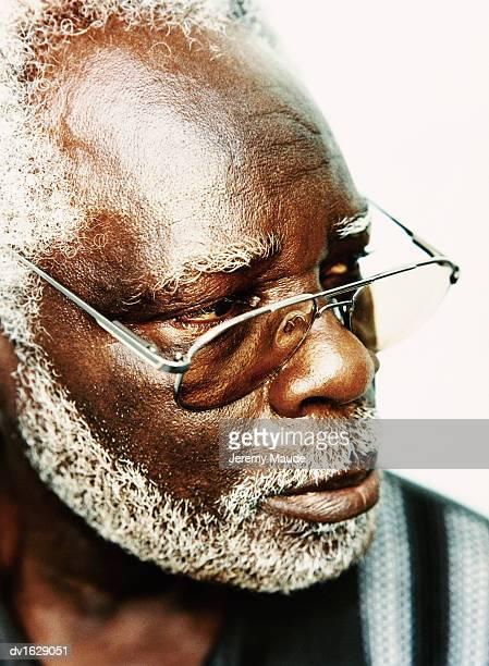 Studio Portrait of an Elderly Man in Sunglasses Looking Sideways