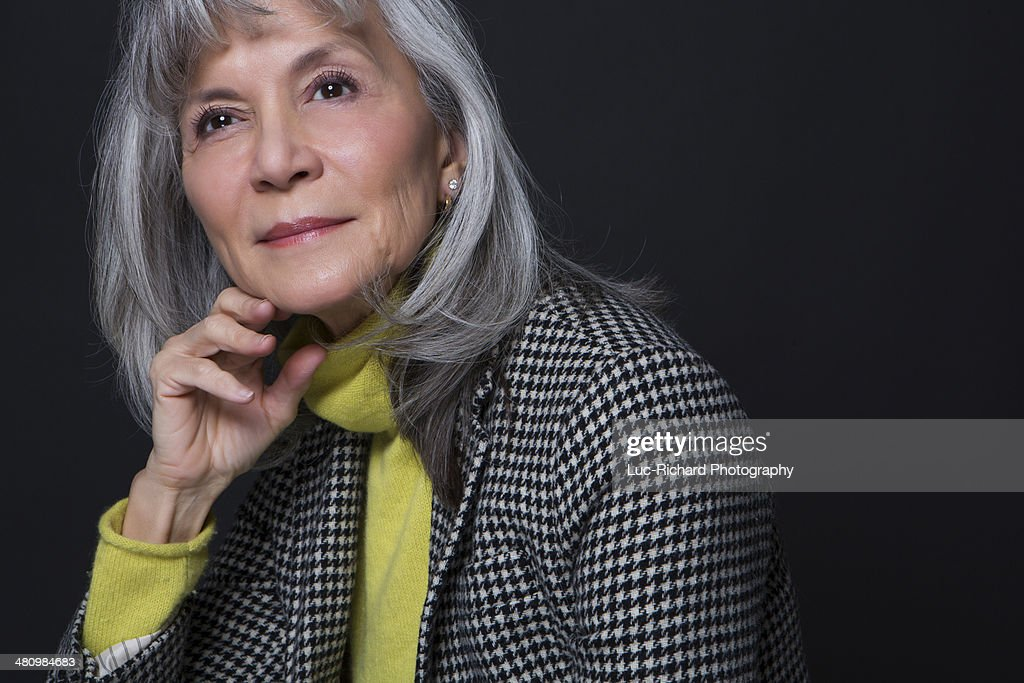 Studio portrait of attractive senior woman : Stock Photo
