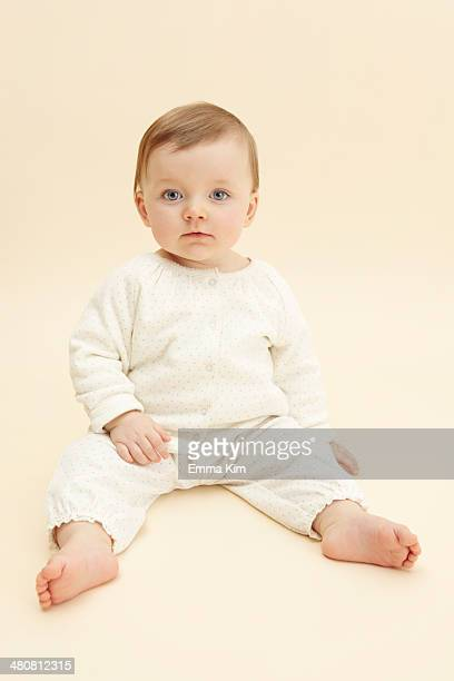 Studio portrait of baby girl staring at camera