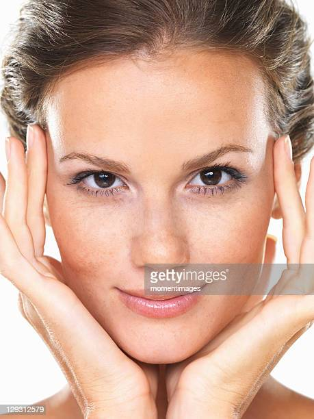 Studio portrait of beautiful brunette smiling