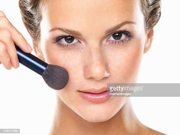 Studio portrait of beautiful woman blushing cheeks