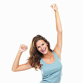 Studio portrait of beautiful woman with fists clenched in victory