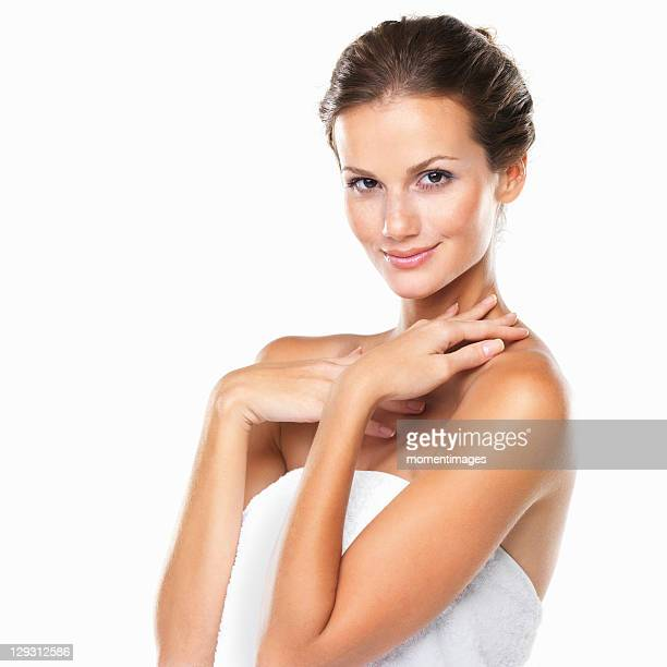 Studio portrait of beautiful woman wrapped in towel