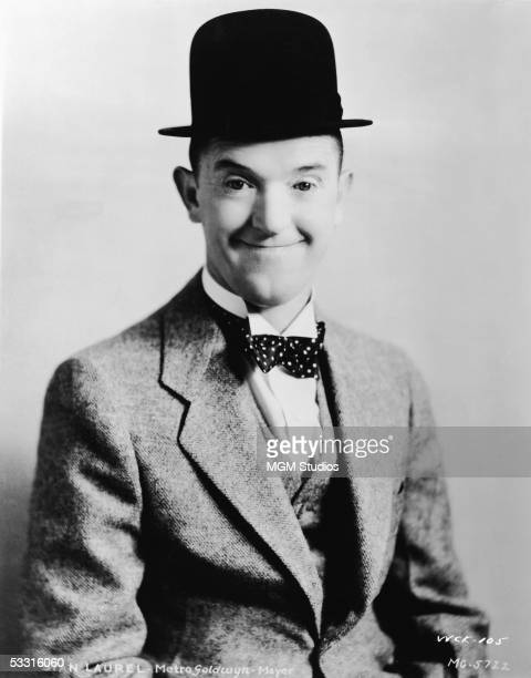 Studio portrait of Britishborn comic actor Stan Laurel dressed in his usual bowler hat and suit 1930s